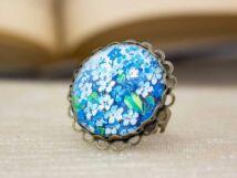 Üveglencsés virágos gyűrű