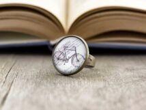 Üveglencsés bicikli gyűrű