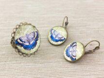 Üveglencsés kék pillangó gyűrű és fülbevaló szett