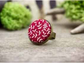 Levelek napnyugtakor textil gombos gyűrű
