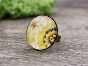 Üveglencsés sárga virágos gyűrű