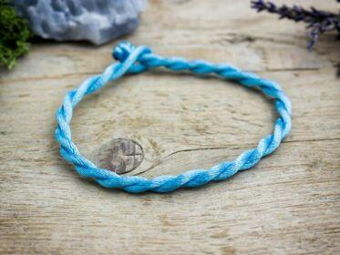 Derűlátás kék textil karkötő