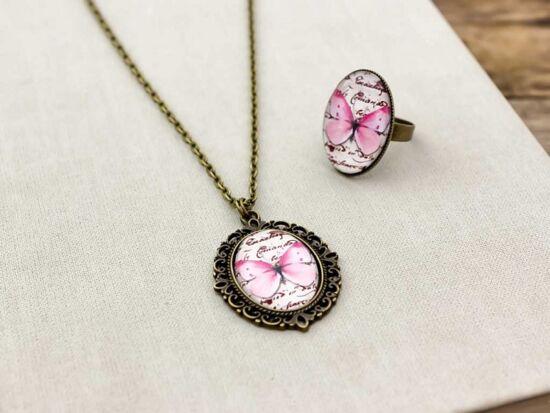 Üveglencsés rózsaszín pillangó gyűrű és nyaklánc szett