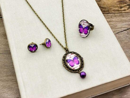 Üveglencsés lila pillangó gyűrű füli és nyaklánc szett