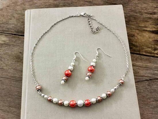 Narancs és fehér gyöngyös nyaklánc és fülbevaló szett