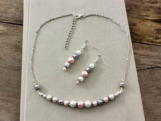 Rózsaszín és fehér gyöngyös nyaklánc és fülbevaló szett