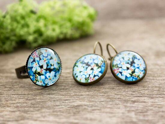 Üveglencsés kék virágos gyűrű és fülbevaló szett