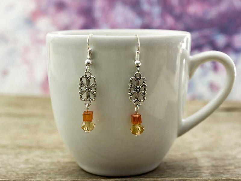 Narancssárga és sárga kristályos lógós fülbevaló