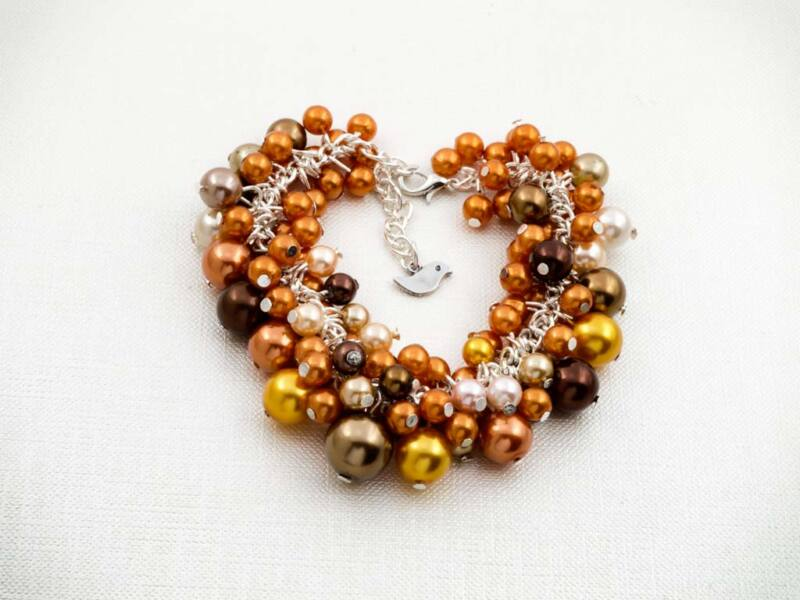 Bubble tekla gyöngyös barna és narancs madárkás karkötő
