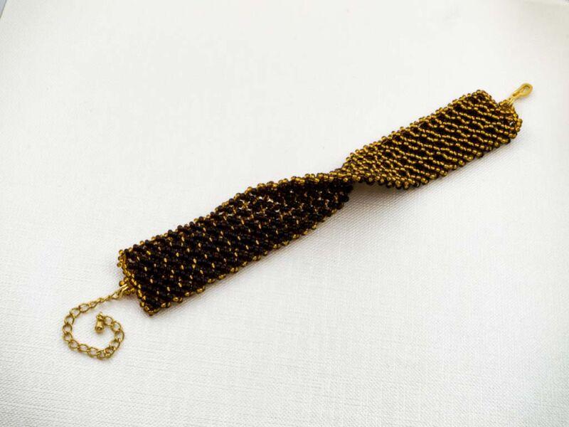 Kétoldalas arany és barna rácsos gyöngy karkötő