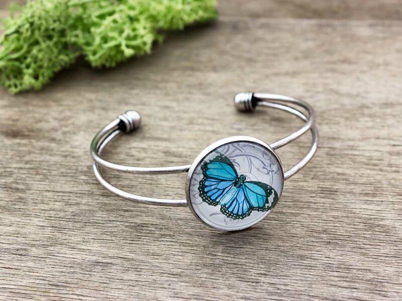 Üveglencsés kék pillangó karperec